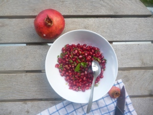 I enjoy eating a pomegranate with finely chopped mint and a touch of salt and or sugar